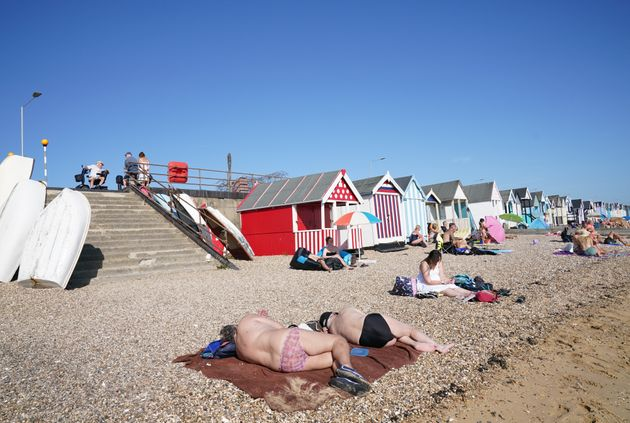 People enjoy the warm weather on the beach at South End on Sea,