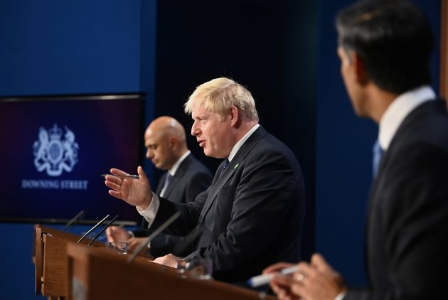 Javid (L), prime minister Boris Johnson and chancellor Rishi Sunak during Tuesday's press briefing on...