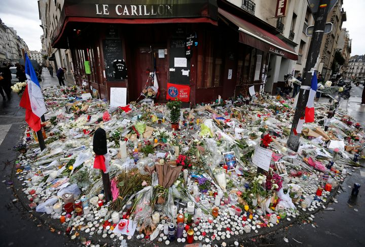 This 2015 file photo shows some of the flowers and candle tributes that were placed at the Restaurant Le Carillon in Paris, a