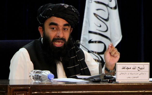 The Taliban's spokesman Zabihullah Mujahid announcing the new interim government on