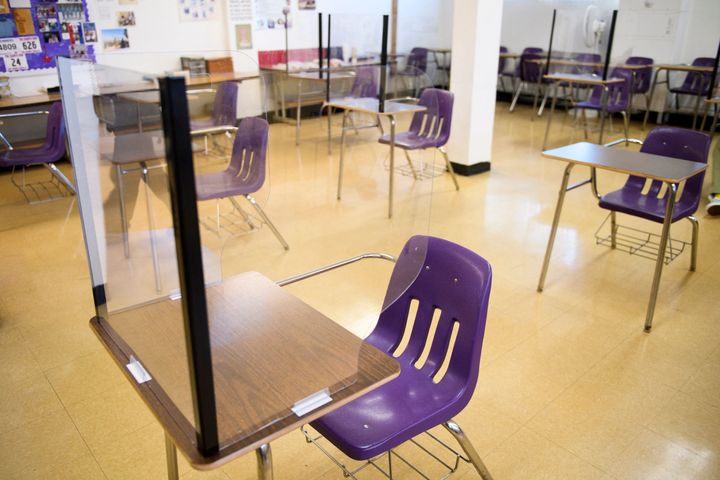 Plexiglass dividers surround desks as students return to in-person learning at a school in Long Beach, California, on March 2