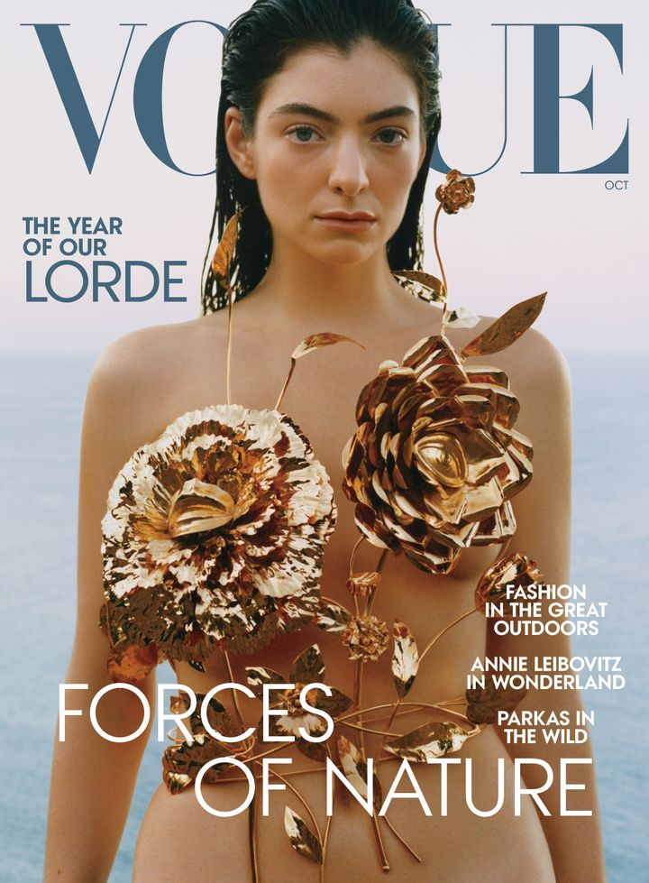 Lorde wears a Schiaparelli top on the cover of Vogue's October issue.