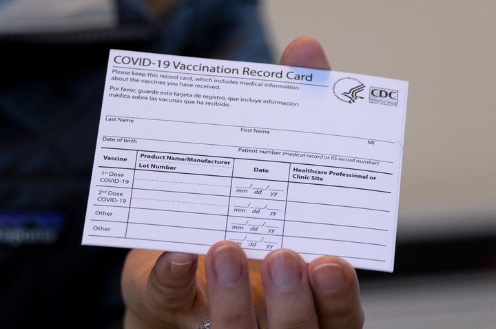 A COVID-19 vaccine card is pictured.Buying, selling or using a counterfeit COVID-19 vaccination card that features an o