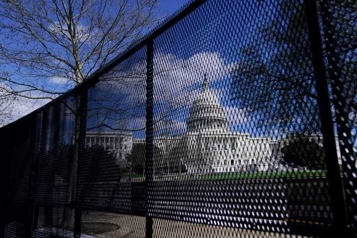 In this April 2, 2021, file photo, the U.S. Capitol is seen behind security fencing on Capitol Hill in Washington. Law enforcement concerned by the prospect for violence at a rally in the nation's Capitol next week are planning to reinstall protective fencing that surrounded the U.S. Capitol for months after the Jan. 6 insurrection there, according to a person familiar with the discussions.