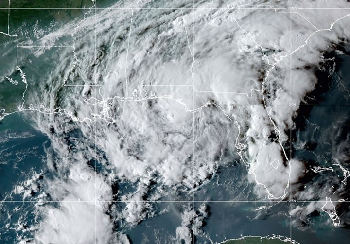 This GOES- East GeoColor satellite image taken Wednesday at 10:30 p.m. EDT. shows Tropical Storm Mindy as it makes landfall on the Florida Panhandle.