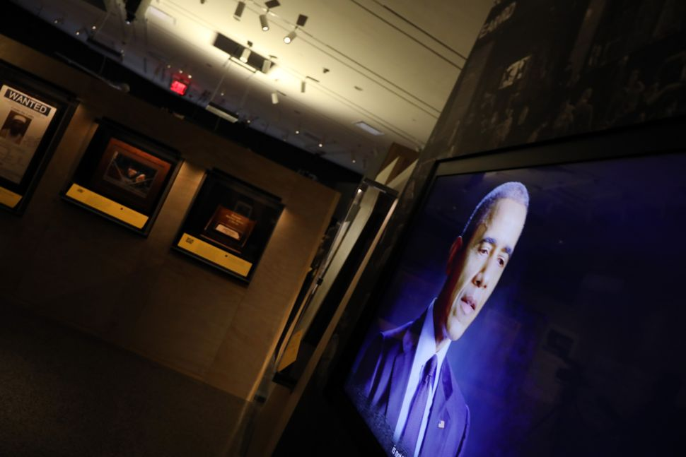 A video of former president Barack Obama shows on a monitor at the exhibition