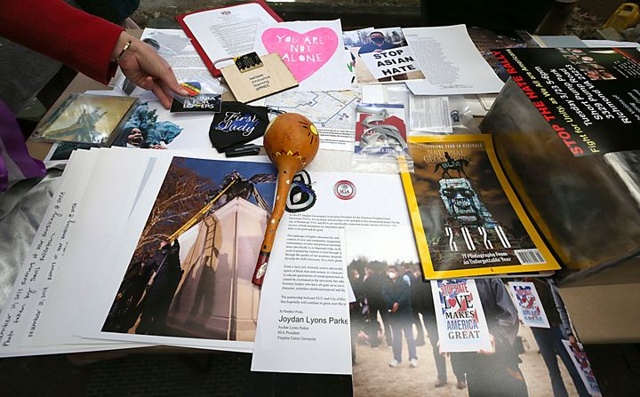 Some of the 39 items placed inside a time capsule that will replace one believed to be in the base of the Robert E. Lee statue.