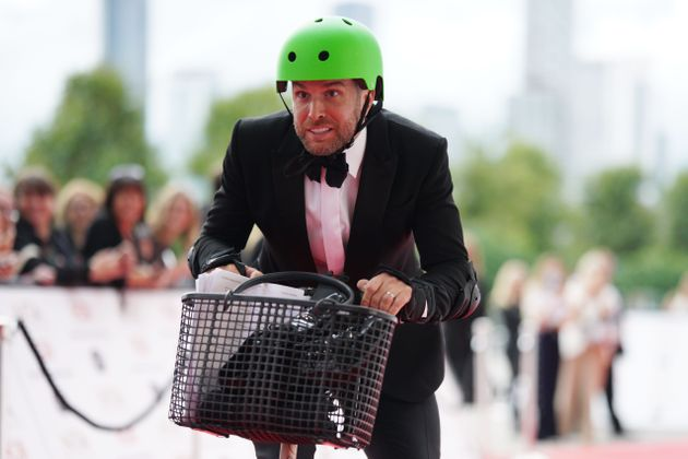 The face of a man desperate not to fall off a scooter in front of the entire nation's