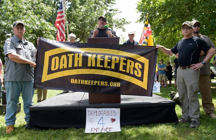 """Stewart Rhodes, founder of the citizen militia group known as the Oath Keepers, center, speaks during a """"rally against political violence"""" outside the White House on June 25, 2017."""