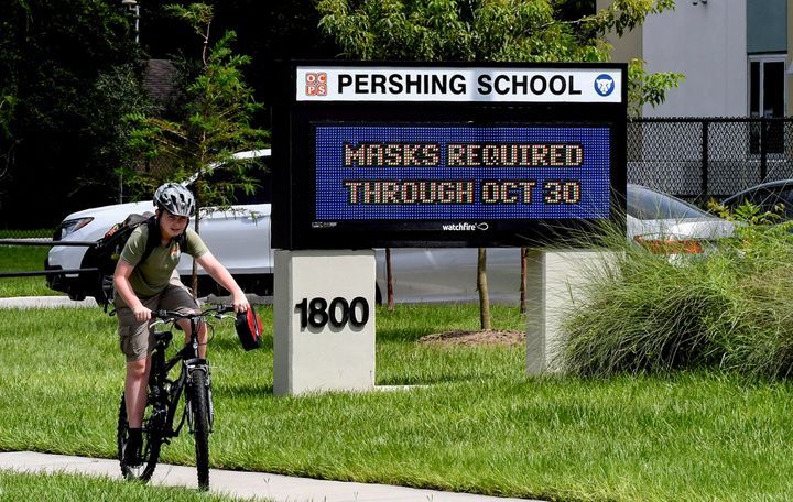 A sign at Pershing School in Orlando advises that face masks are required for students through Oct. 30. On Aug. 27, a Florida judge threw out Gov. Ron DeSantis' ban on face mask mandates in schools.