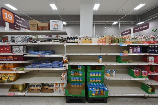 Empty shelves are pictured where cartons of fruit juice would be stocked inside a Sainsbury's supermarket...