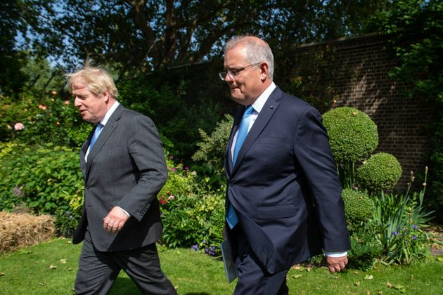 Boris Johnson and Scott Morrison in June drafting up a free trade