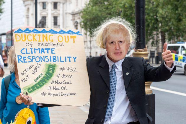 Extinction Rebellion protesters with a Boris Johnson