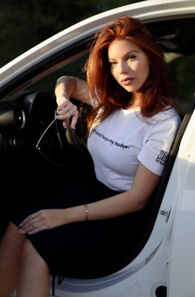 The author wearing a T-shirt from her Networthy clothing line.