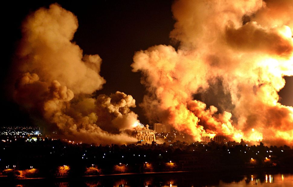 """Fires rage on the west bank of the Tigris River on March 21, 2003, in Baghdad during the U.S. """"Shock and Awe"""" bombing campaig"""