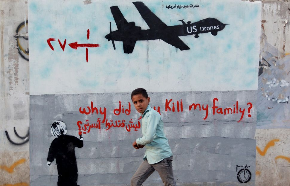 """A mural depicting a U.S. drone says, """"Why did you kill my family?"""" in Sanaa, Yemen, on Dec. 13, 2013. A drone strike on a wed"""