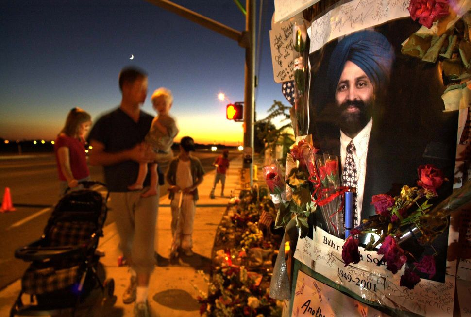 Visitors paid tribute at a memorial for Balbir Singh Sodhi at the Arizona gas station where he was murdered on Sept. 15, 2001