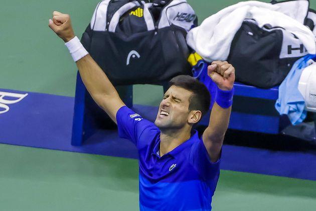 epa09460564 Novak Djokovic of Serbia reacts after defeating Alexander Zverev of Germany in a men's singles...