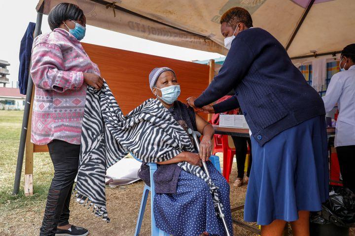A woman receives the AstraZeneca coronavirus vaccine at Kenyatta National Hospital in Nairobi, Kenya, on Aug. 26.