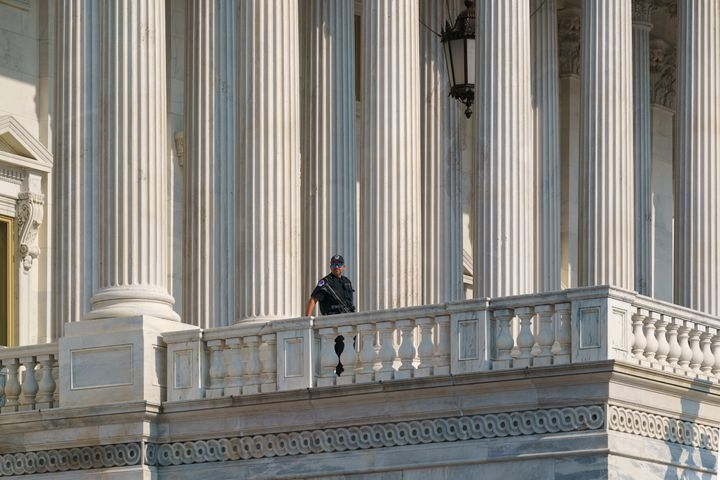 A U.S. Capitol Police officer keeps watch at the House of Representatives in July.More than 100 police officers were in