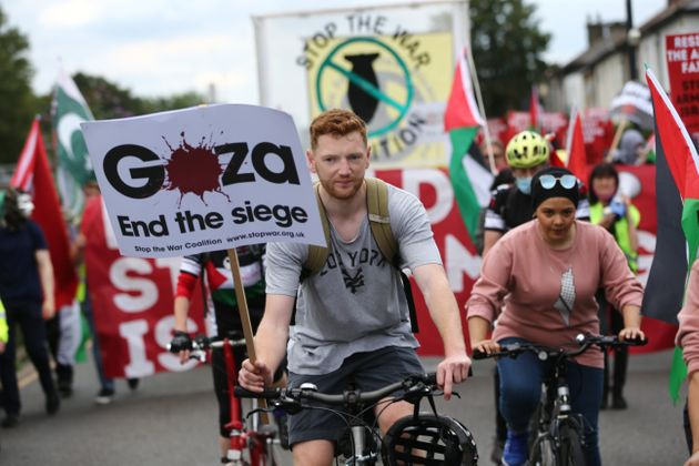 Pro-Palestine protesters march against the Defence and Security Equipment International (DSEI) fair on...