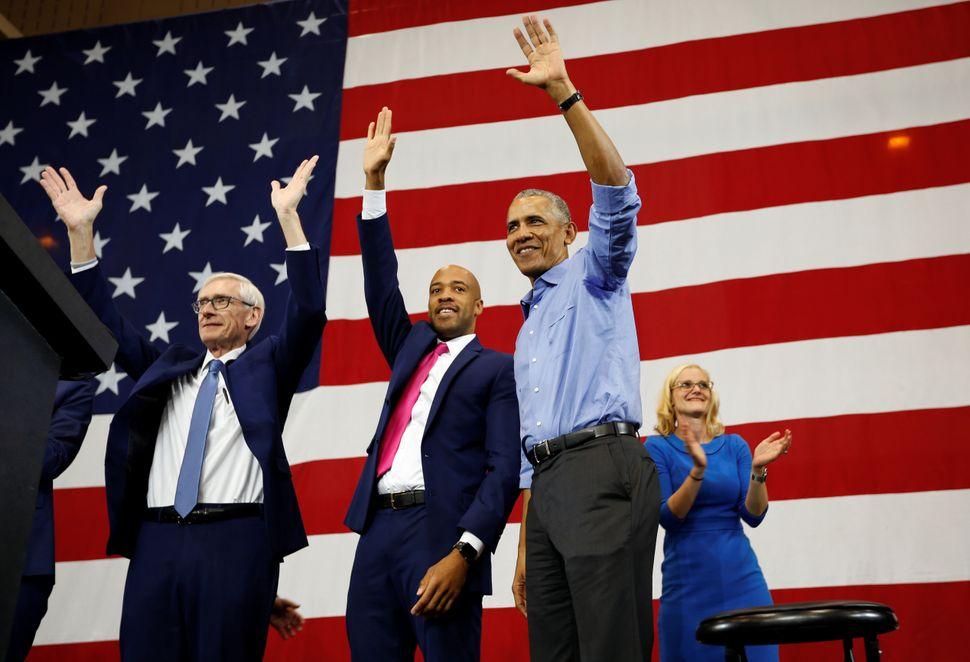 Former President Barack Obama campaigns for Democrats Tony Evers (left) for governor, Mandela Barnes for lieutenant governor