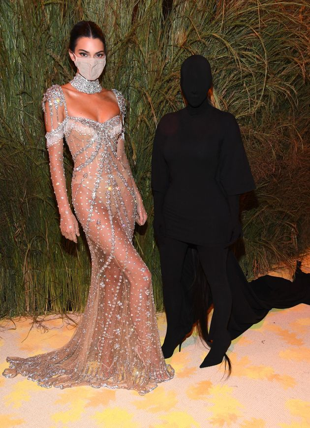 Kendall Jenner poses with Kardashian at the Met