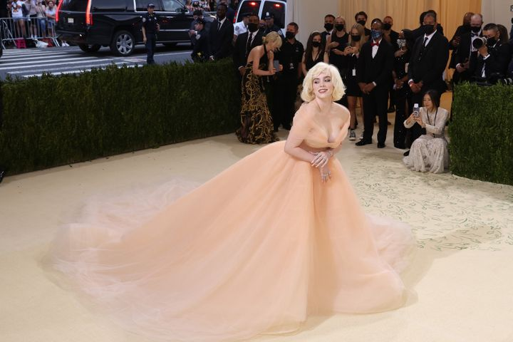 """Billie Eilish, seen wearing an Oscar de la Renta gown at the 2021 Met Gala benefit """"In America: A Lexicon of Fashion,"""" will s"""