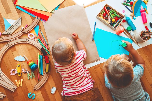 Kids draw and make crafts. Children with educational toys and school supplies for creativity. Background...