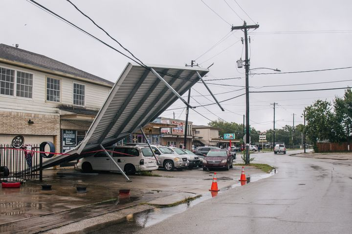 A carport hangs from power-lines after Tropical Storm Nicholas moved through the area Tuesday in Houston, Texas.