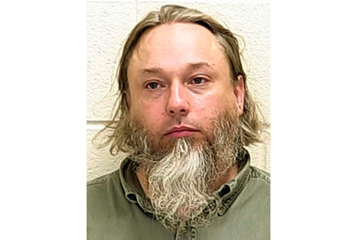 This undated file photo provided by The Ford County Sheriff's Office in Paxton, Ill., shows Michael Hari, a militia leader co