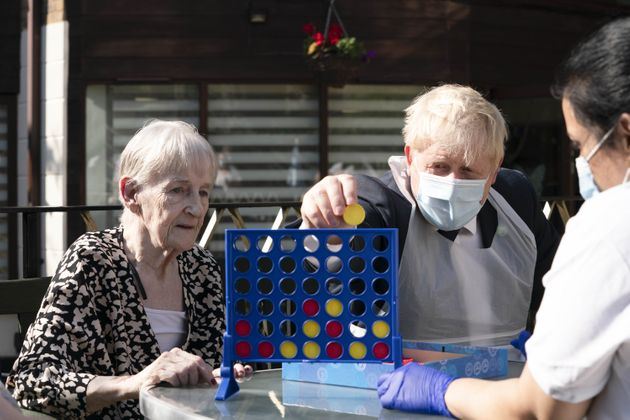 Boris Johnson during a visit to Westport Care Home in Stepney Green, east London, ahead of unveiling...