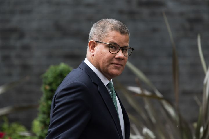 """COP26 President Alok Sharma leaves after a weekly Cabinet meeting in London on Tuesday. He said the British government had offered to pay for quarantine hotel stays for registered delegates arriving from """"red list"""" areas and to vaccinate delegates """"who would be unable otherwise to get vaccinated."""""""