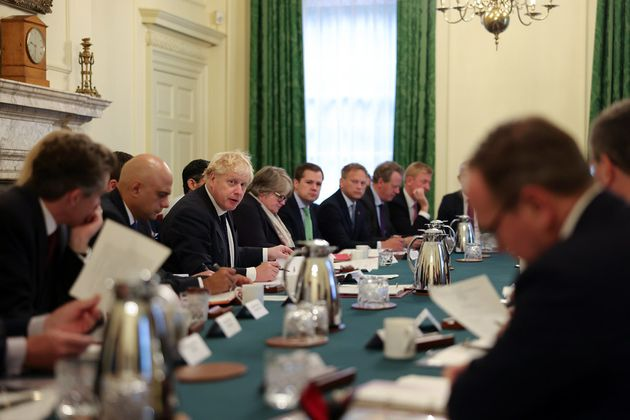 Between 30 and 40 ministers crowded together for a cabinet minister in this photograph, released on