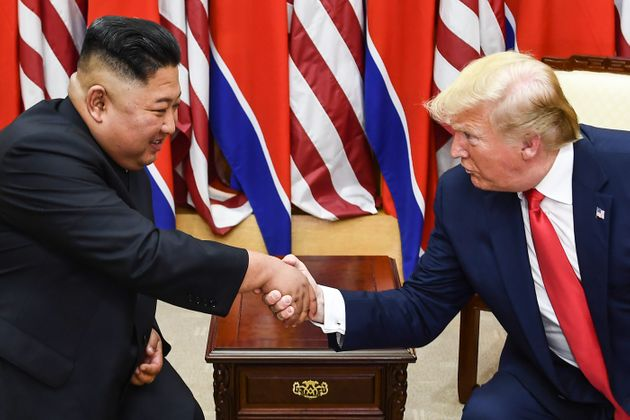 Kim Jong Un and US President Donald Trump shake hands in 2019 before discussing