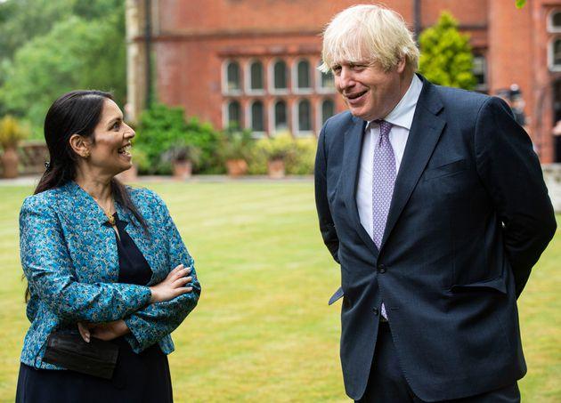 Prime minister Boris Johnson, with home secretary Priti Patel in