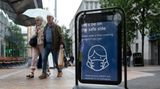 Shoppers pass a sign encouraging people to wear masks to reduce the transmission of the coronavirus outside of a Tesco supermarket. The U.K. has the second highest number of COVID-19 cases, according to the WHO.