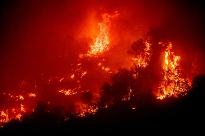 Flames from the KNP Complex Fire burn a hillside above the Kaweah River in Sequoia National Park.