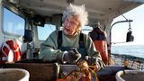 Virginia Oliver, age 101, works as a sternman, measuring and banding lobsters on her son Max Oliver's boat, Tuesday, Aug. 31, 2021, off Rockland, Maine. The state's oldest lobster harvester has been doing it since before the onset of the Great Depression. (AP Photo/Robert F. Bukaty)