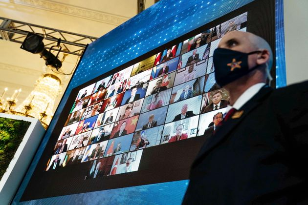 World leaders are displayed on a screen in the East Room of the White House during the virtual Leaders...