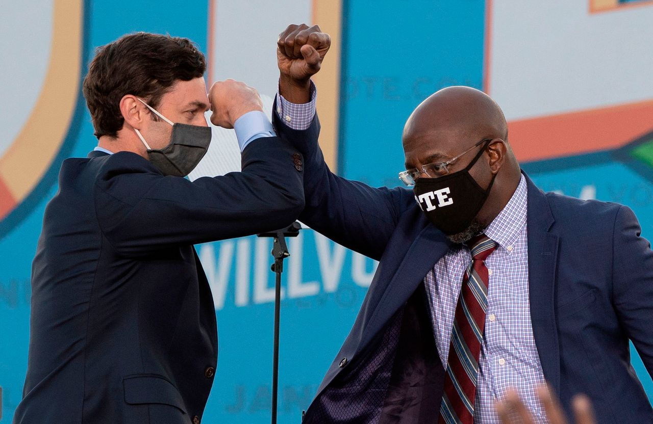 Victories in a pair of runoff elections in January made Jon Ossoff (left) the first Jewish U.S. senator ever elected in Georgia and the Rev. Raphael Warnock the first Black senator in the state's history.