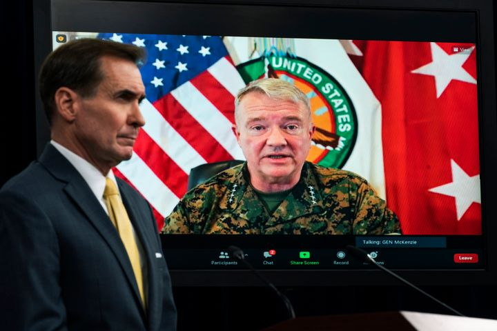 Gen. Frank McKenzie, Commander of U.S. Central Command, appears on screen as he speaks from MacDill Air Force Base, in Tampa, Fla., about Afghanistan during a virtual briefing moderated by Pentagon spokesman John Kirby at the Pentagon in Washington. The Pentagon retreated from its defense of a drone strike that killed multiple civilians in Afghanistan last month, announcing Friday, Sept. 17, that an internal review revealed that only civilians were killed in the attack, not an Islamic State extremist as first believed. (AP Photo/Manuel Balce Ceneta, File)