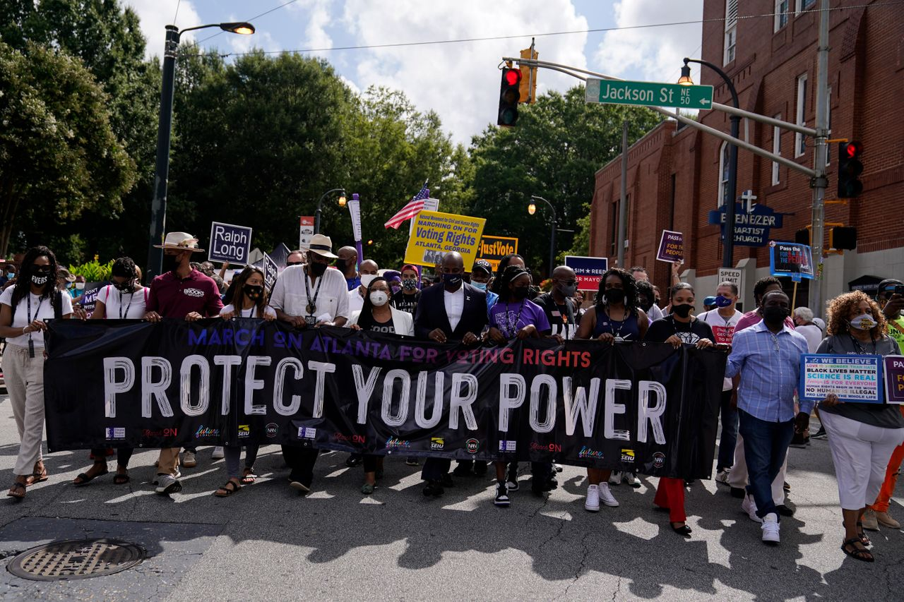 Atlantans demonstrate in favor of federal voting rights legislation on Aug. 28, the 58th anniversary of the March on Washington, which paved the way for the passage of the Civil Rights Act of 1964 and the Voting Rights Act of 1965.