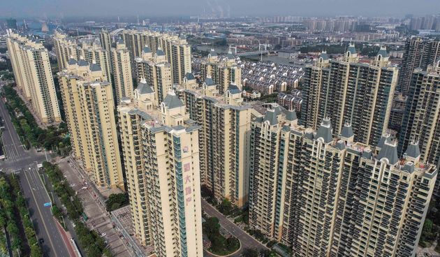 This aerial photo taken on September 17, 2021 shows a housing complex by Chinese property developer Evergrande...