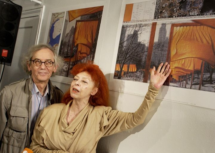 """Christo (L) and his wife Jeanne-Claude (R) announce details of their collaborative project, """"The Gates, Central Park, New York City, 1979-2005"""", in 2004."""