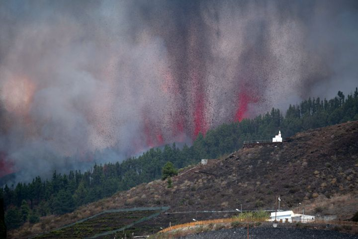 Mount Cumbre Vieja erupts spewing out a column of smoke, ash and lava as seen from Los Llanos de Aridane on the Canary island of La Palma on September 19.