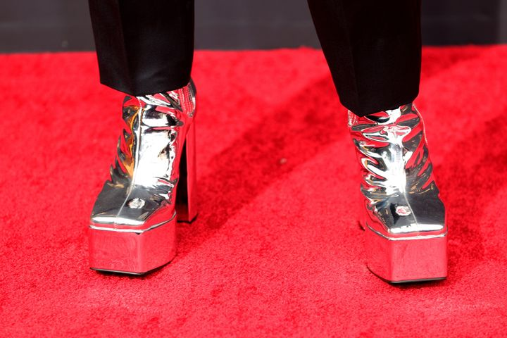 Bowen Yang wore silver platform heels by Syro.