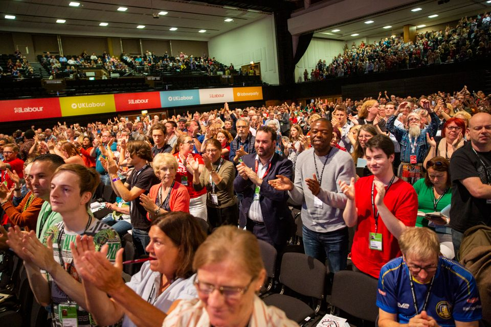 Delegates give a standing ovation after a speech at the Labour Party conference in