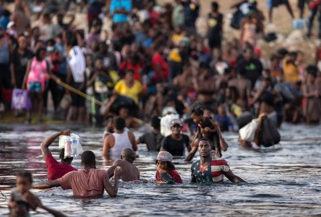 CIUDAD ACUNA, TEXAS - SEPTEMBER 19: Immigrants, mostly from Haiti gather on the bank of the Rio Grande...