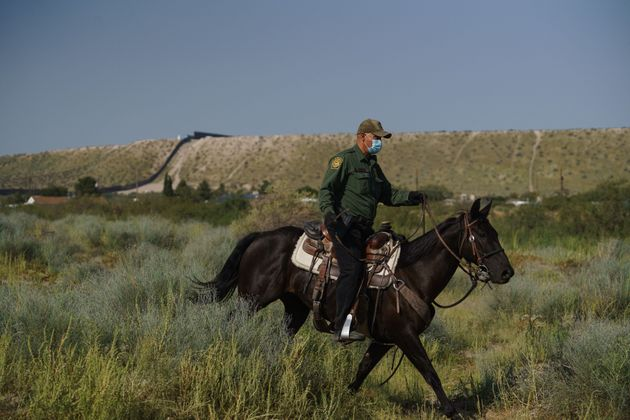 A US border patrol officer on horseback at the US-Mexico border in Sunland